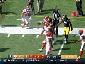 Brown stiff arms defender, picks up first down