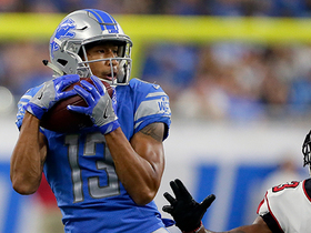 T.J. Jones hauls in the 20-yard pass from Matthew Stafford