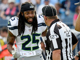 Watch: Richard Sherman flirts with ejection after holding call negates interception