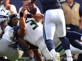 Watch: Russell Wilson sacked for a 9-yard loss after fumbled snap
