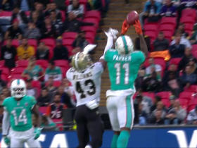 DeVante Parker snags pass over leaping defender for 21-yard gain