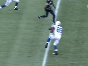 Brandon Williams carries two defenders on 32-yard catch