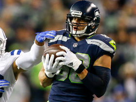 Jimmy Graham holds on to Russell Wilson's dart pass in traffic
