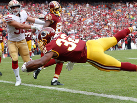 Samaje Perine rolls into the end zone for his first career TD