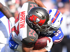 Doug Martin fights through contact for a first down