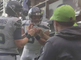 Seahawks fans cheer for Russell Wilson as he takes the field