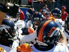 Aqib Talib and the Broncos defense huddle up before running onto field