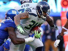 Thomas Rawls takes on Giants defenders after dump pass
