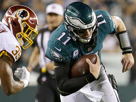 Watch: Carson Wentz uses wheels, jukes Redskins defender to turf