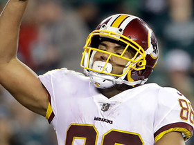 Jordan Reed bowls over five Eagles defenders on TD catch