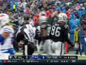 Lee Smith out-muscles Trae Elston and lands at the 1-yard line