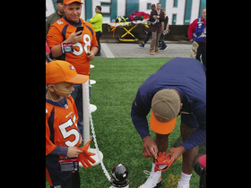 Von Miller signs his gloves for young fan