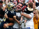 Watch: Ted Ginn gives ball to infant Saints fan in the stands after TD