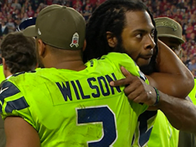 Richard Sherman embraces Russell Wilson on sideline after going out with injury
