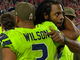 Watch: Richard Sherman embraces Russell Wilson on sideline after going out with injury