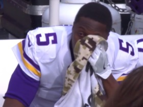 Teddy Bridgewater wipes away tears on the sideline