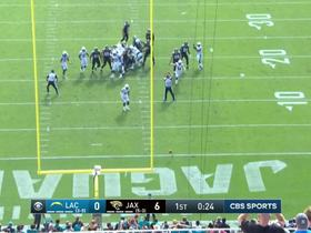 Corey Liuget leaps to block Jaguars extra point