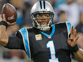 Cam Newton throws a dart to Curtis Samuel amid three defenders