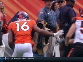Bennie Fowler ducks under a tackle, takes off for 18 yards