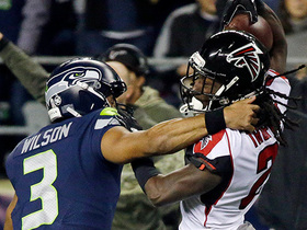 Wilson throws INT to Trufant, then chases him down for big tackle