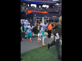 Dolphins run out to boos in Foxborough