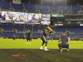 Texans players play baseball during warmups