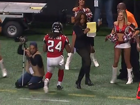 Pam Oliver dodges Devonta Freeman as he runs out of bounds
