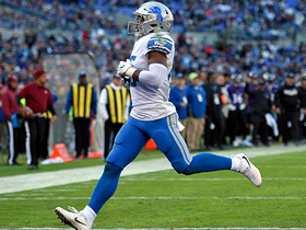 Theo Riddick sneaks out to the right for 4-yard TD