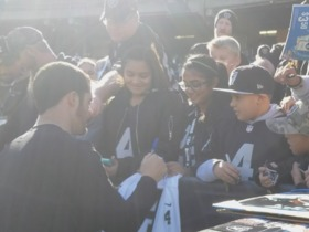 Derek Carr signs autographs before Week 13 game