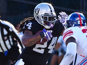 Marshawn powers his way forward to convert fourth down