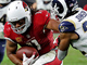 Watch: Larry Fitzgerald slips tackle to pick up 13 yards