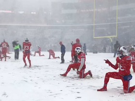 Bills get hyped up while warming up in snow
