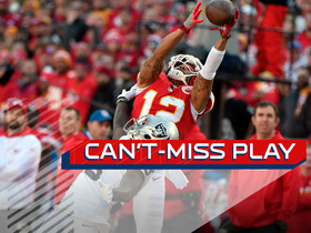 Can't-Miss Play: Wilson goes up, somehow keeps both feet in for 36 yards