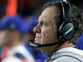 Bill Belichick fist-bumps offensive players after scoring drive