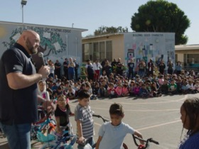 Watch: Andrew Whitworth wheels out joy with new bikes for elementary school students