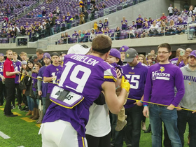 Adam Thielen kisses his wife and baby before game vs. Bengals