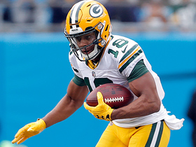 Cobb converts critical fourth down on pass from Rodgers