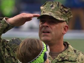 Armed Service member is reunited with family during Seahawks game