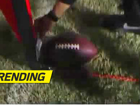 Referee uses index card to determine if Cowboys reached first-down marker