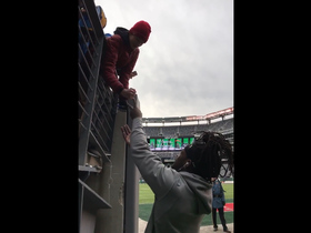 Melvin Gordon plays rock paper scissors with a fan