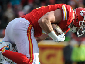 Travis Kelce leaps for an 18-yard throw from Smith