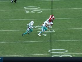 Demetrius Harris powers through three Dolphins for first down catch