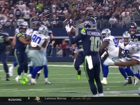 Russell Wilson throws a dart under pressure on third-and-8