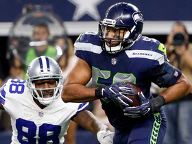 Cowboys welcome back K.J. Wright with tip-drill INT