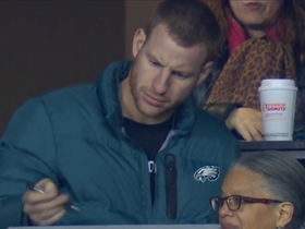 Carson Wentz takes notes on game from press box