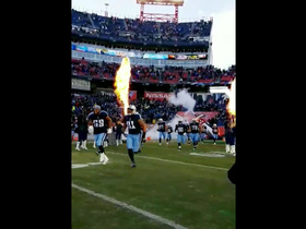 Titans run out of the tunnel with fiery entrance