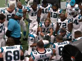 Cam Newton gathers offense on the sideline to get them fired up