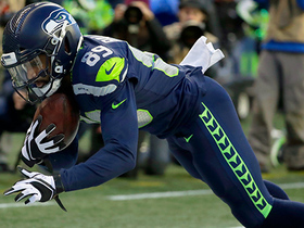 Watch: Doug Baldwin extends for incredible toe-tap TD catch to tie the game