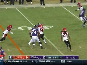 Buck Allen drags the whole pile on a gritty 19-yard run