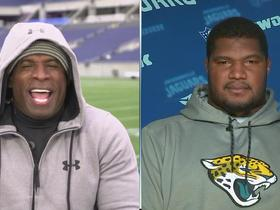 Deion talks with Calais Campbell before the Jaguars' Sunday game